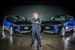Portrait of Roberto Alagna infront of two Range Rovers .Portrait photography Brisbane.