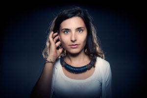 Portrait photography Brisbane. Portrait of young female model. taken in Brisbane studio. Dark background. Photography by Joseph Byford