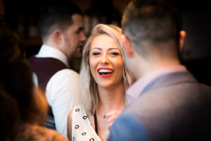 Engagement party photography in Brisbane. Candid photo of guest laughing.