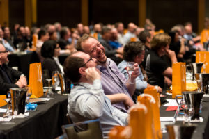 two people enjoying a conference