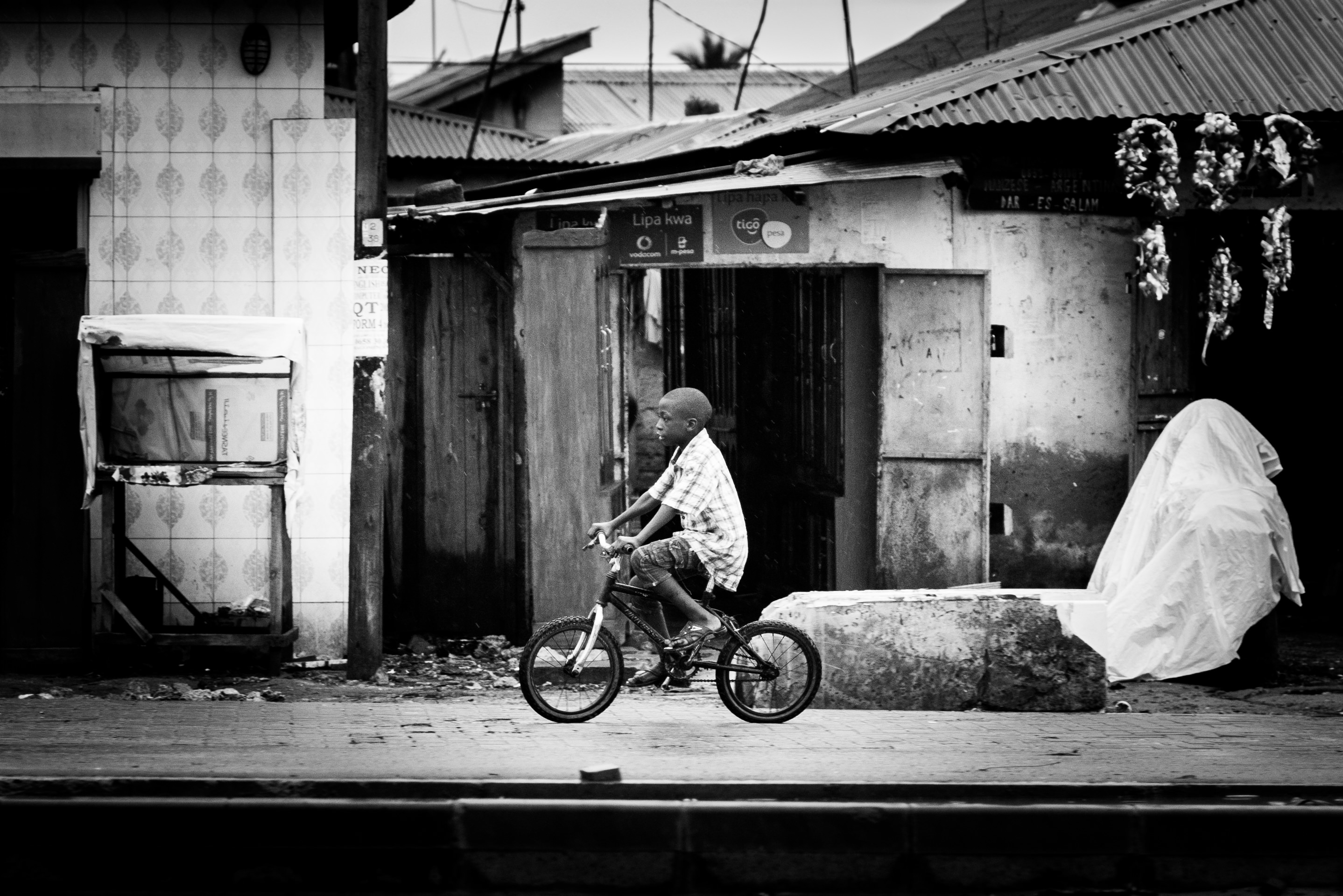 Child riding a bicycle on the streets of Tanzania