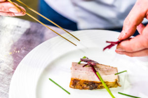 Food being plated at the Good Food and Wine Festival in Brisbane. Food Photography Brisbane by Joseph Byford