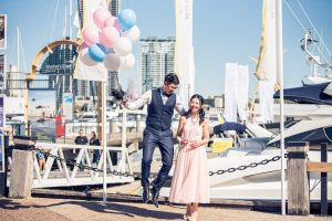 Wedding photograph of couple with balloons in QLD.