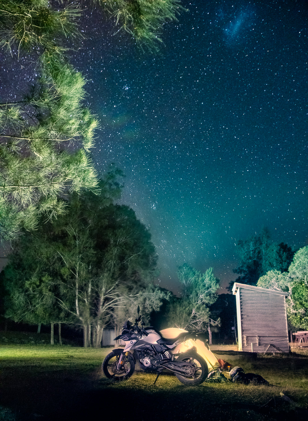 ADV Bike BMW G310GS parked outside a tent in a camp spot in NSW, Australia. Photograph by Joseph Byford.
